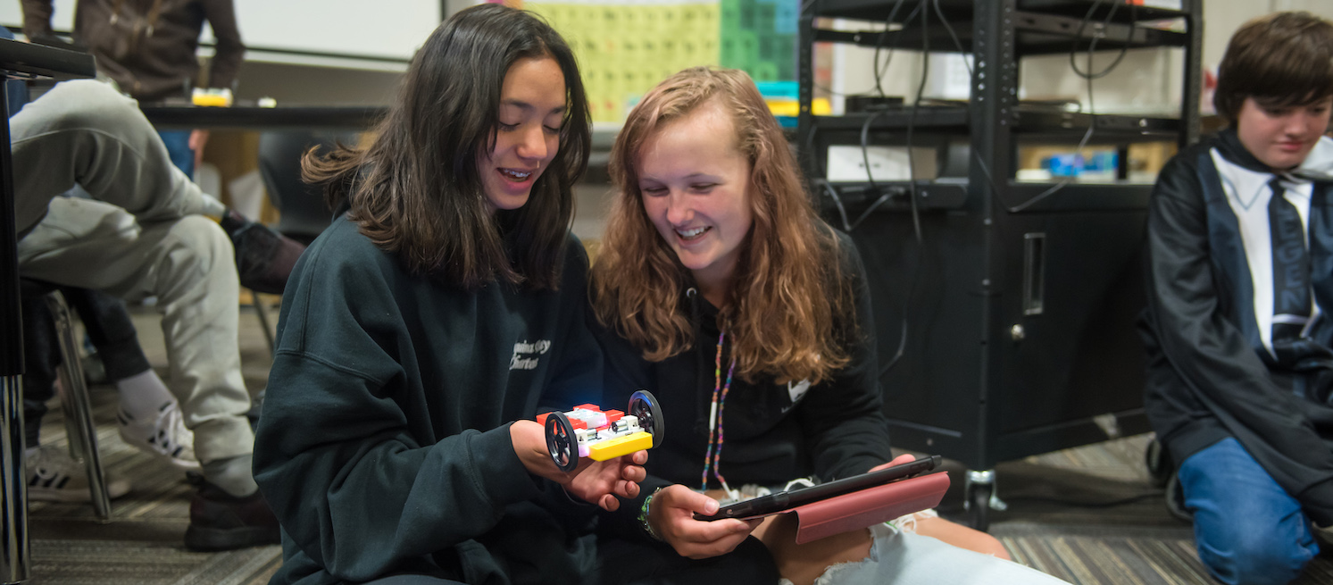 students at Realms High work on robotics